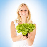 Happy woman holding green salad Royalty Free Stock Photography