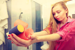 Happy woman holding hair rollers in bathroom. Styling at home concept. Happy woman holding hair rollers in bathroom about to make fancy coiffure Royalty Free Stock Photography