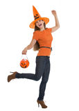 Happy woman holding Halloween bucket Stock Images