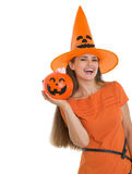 Happy woman holding Halloween bucket Stock Photo