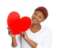 Happy woman holding heart Royalty Free Stock Photography