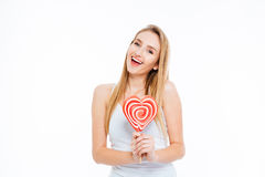 Happy woman holding heart shaped lollipop Stock Images