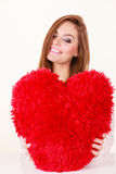 Happy woman holding heart shaped pillow Royalty Free Stock Photo