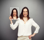 Happy Woman Holding Her Sad Picture Stock Images