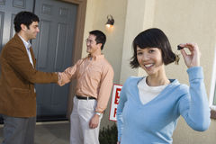 Happy Woman Holding House Keys Royalty Free Stock Image
