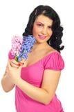 Happy woman holding hyacinth Stock Photo