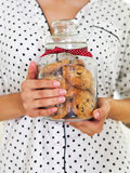 Happy woman holding jar with coockies Stock Photos