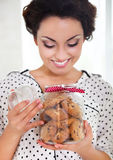 Happy woman holding jar with coockies in her kitchen Stock Image