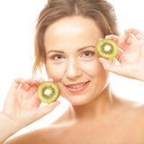 Happy woman holding kiwi Royalty Free Stock Photo