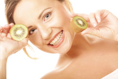 Happy woman holding kiwi Stock Images
