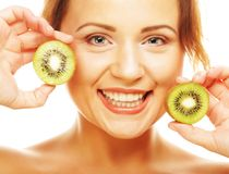 Happy woman holding kiwi Stock Photo
