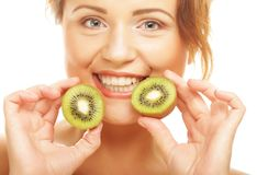 Happy woman holding kiwi Stock Photography