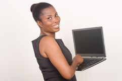 Young happy businesswoman holding a laptop Stock Photography