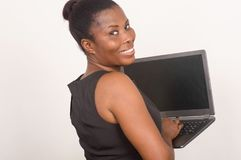 Young happy businesswoman holding a laptop Stock Photo