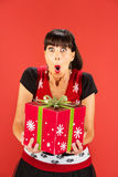 Happy woman holding large Christmas box Royalty Free Stock Images