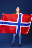 Happy woman holding a large flag of Norway Stock Photos