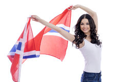 Happy woman holding a large transparent flag of Norway Royalty Free Stock Image