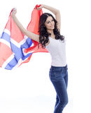 Happy woman holding a large transparent flag of Norway Stock Photo