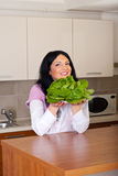 Happy woman holding lettuce Stock Photo