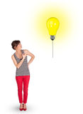 Happy woman holding a light bulb balloon Stock Images