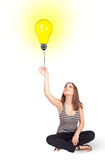 Happy woman holding a light bulb balloon Royalty Free Stock Photography