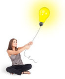 Happy woman holding a light bulb balloon Royalty Free Stock Image