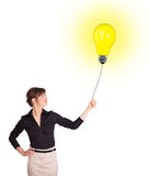 Happy woman holding a light bulb balloon Royalty Free Stock Images