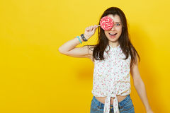 Happy woman holding a lollipop. Royalty Free Stock Photo