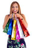 Happy woman holding lots of shopping bags Royalty Free Stock Photo