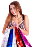 Happy woman holding lots of shopping bags Stock Photography