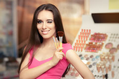 Happy Woman Holding a Make-up Brush Stock Image
