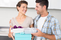 Happy woman holding many gifts from her partner Stock Photo