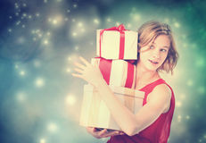 Happy woman holding a many present boxes Royalty Free Stock Photo