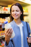 Happy woman holding milk bottle in market Stock Photography