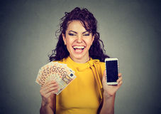 Happy woman holding mobile phone euro banknotes cash Royalty Free Stock Photos