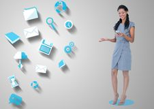 Happy woman holding mobile phone and various application icons in background. Digital composition of happy woman holding mobile phone and various application Royalty Free Stock Image