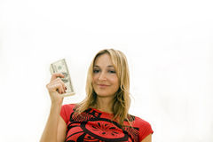 Happy woman holding money Stock Photos