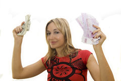 Happy woman holding money Stock Photo