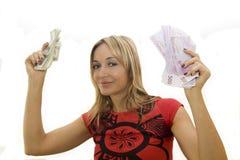 Happy woman holding money Stock Photo