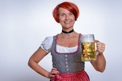 Happy Woman Holding a Mug of Cold Beer Stock Photos