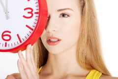 Happy woman holding office clock Stock Photography