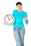 Happy woman holding office clock Stock Photo