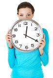 Happy woman holding office clock Royalty Free Stock Image