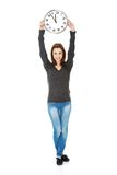 Happy woman holding office clock Stock Image