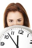 Happy woman holding office clock Royalty Free Stock Photography
