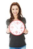 Happy woman holding office clock Stock Photos