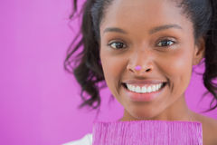 Happy woman holding paintbrush with paint on her nose Royalty Free Stock Photography