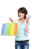 Happy woman holding paper bag and money Stock Images