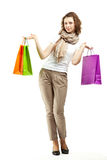 Happy woman holding paper bags Royalty Free Stock Images