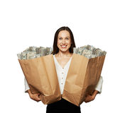 Happy woman holding paper bags Stock Images